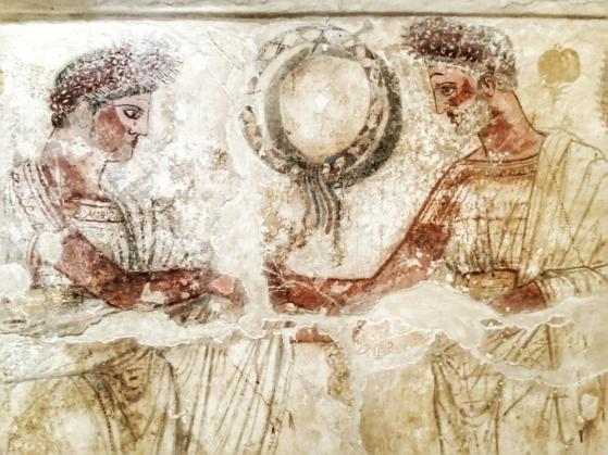 Tomba della Finanza. Il defunto tende la mano verso un uomo anziano con la barba, forse un antenato.